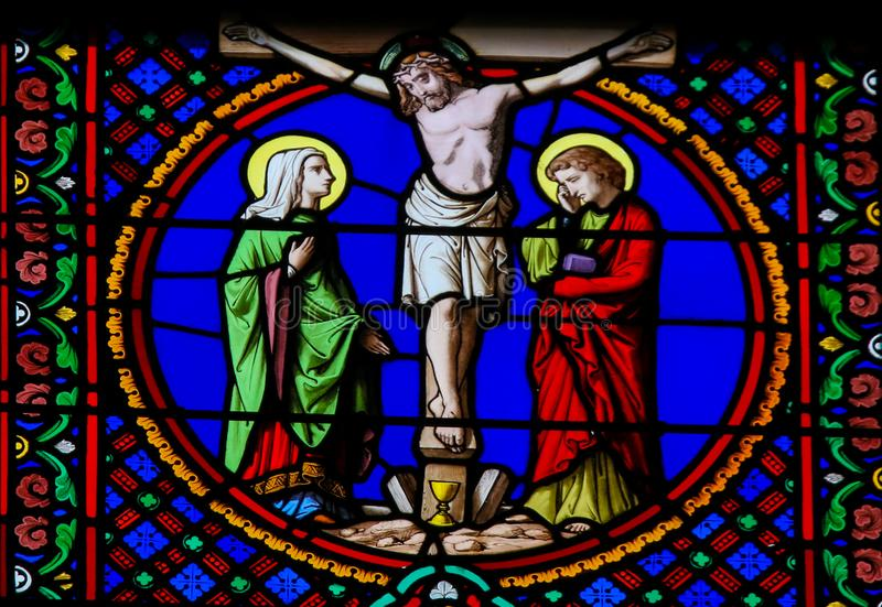 Stained Glass in Notre-Dame-des-flots, Le Havre - Crucifixion of Jesus. Stained Glass in the Chapel of Notre-Dame-des-flots & x28;1857& x29; in Sainte Adresse stock photos
