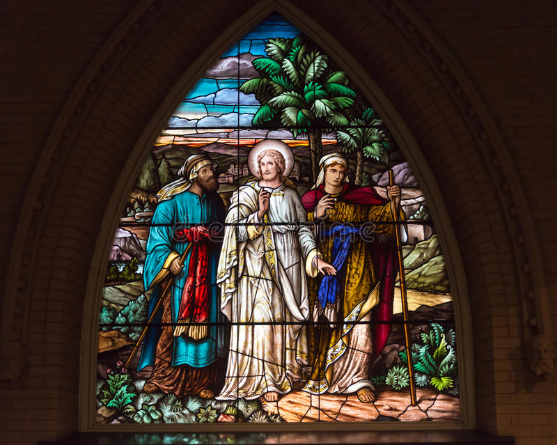 Stained Glass Church of the Redeemer, Toronto. Jesus on the Road to Emmaus: Beautiful stained glass windows at the Church of the Redeemer in downtown Toronto royalty free stock image