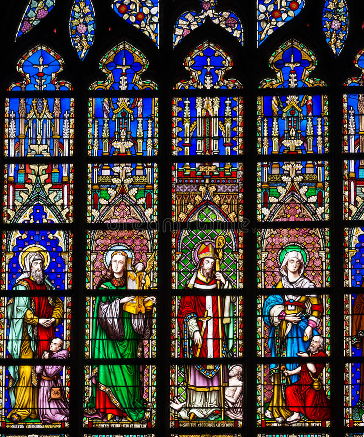 Stained glass in church. Stained glass window in the Church of Our Lady of Sablon (Notre Dame du Sablon) made in 1861 by the artist Samuel Coucke (1833-1899 stock photo