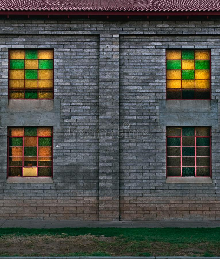 Stained glass, cinder block walls. royalty free stock photo