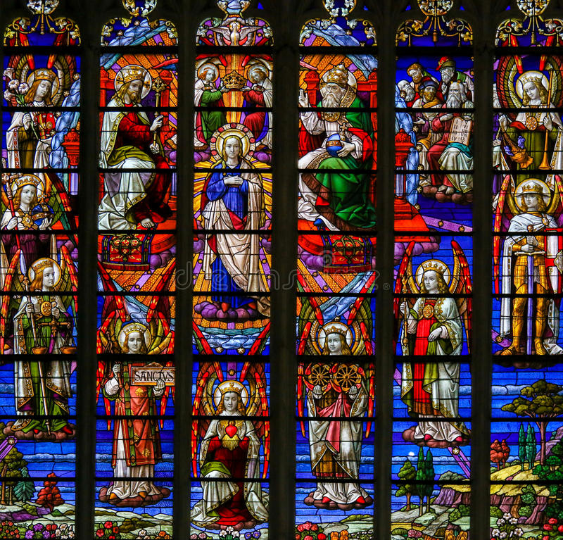 Stained Glass - Coronation of Mother Mary by the Holy Trinity stock images