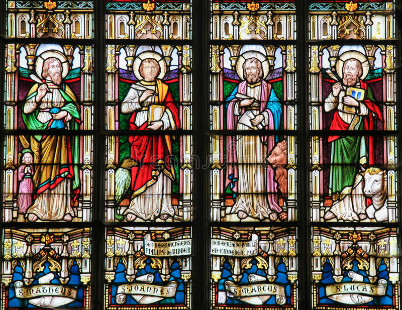 Stained Glass depicting the Four Evangelists. Stained glass window depicting the Four Evangelists, Saint Matthew, Saint John, Saint Mark and Saint Luke, in the stock photography