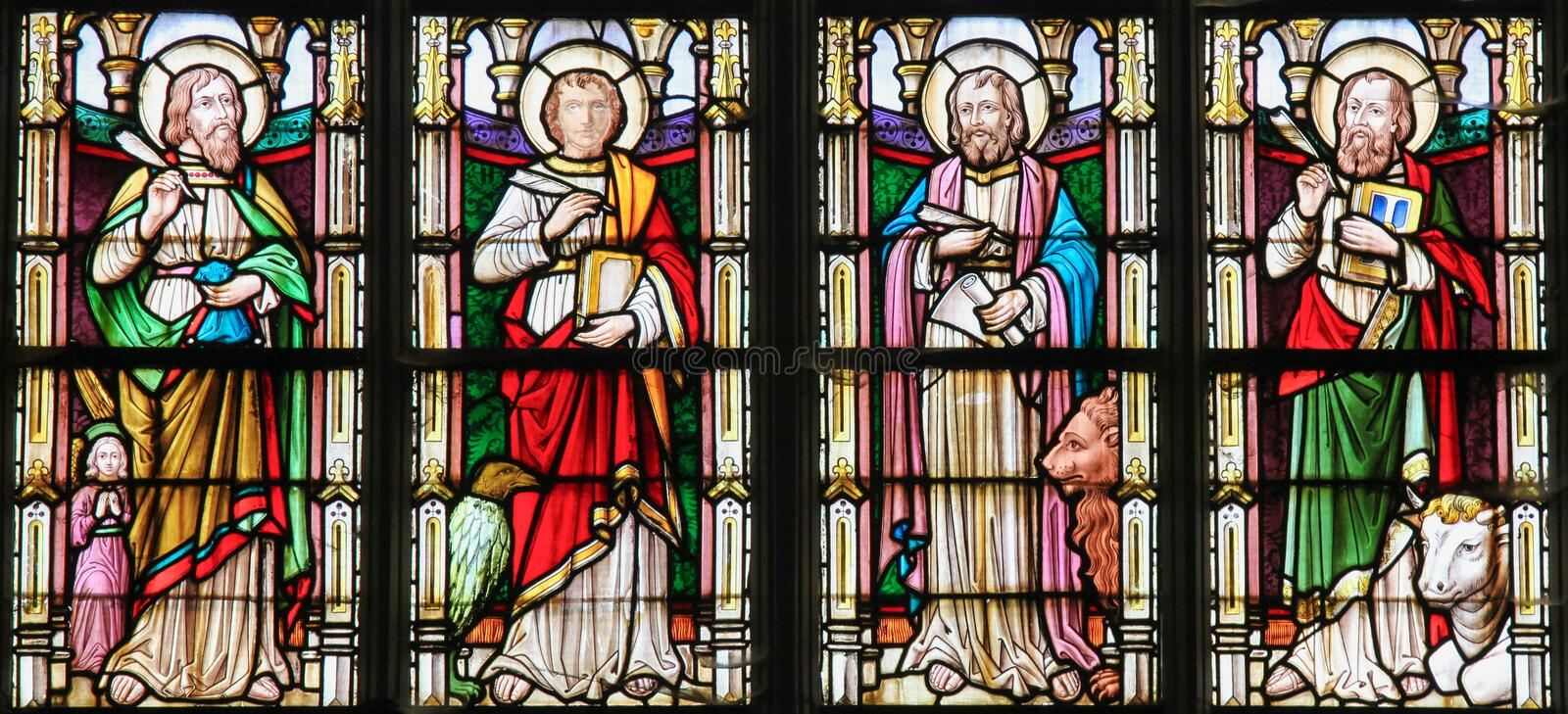 Stained Glass depicting the Four Evangelists. Stained glass window depicting the Four Evangelists, Saint Matthew, Saint John, Saint Mark and Saint Luke, in the royalty free stock image