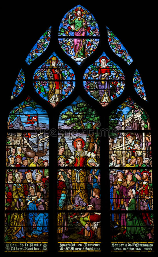 Stained glass depicting St Mary Magdalene's apostleship to Provence. Shot in Church of Saint Severin, Paris. Stained glass depicting St Mary Magdalene's stock photography