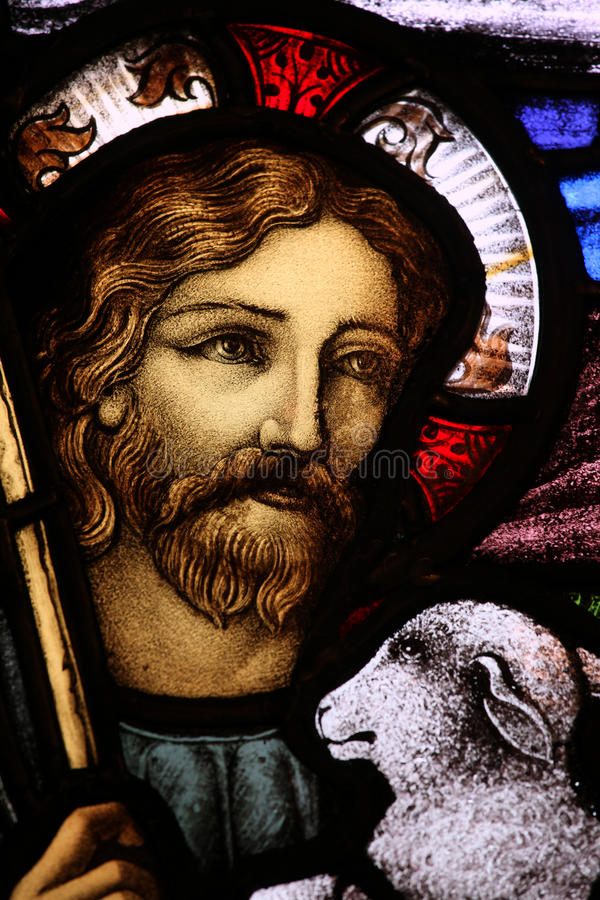 Stained Glass Detail. Detail of stained glass window depicting Jesus holding a lamb. From St. Paul's Church (1749), Halifax, Nova Scotia stock photography