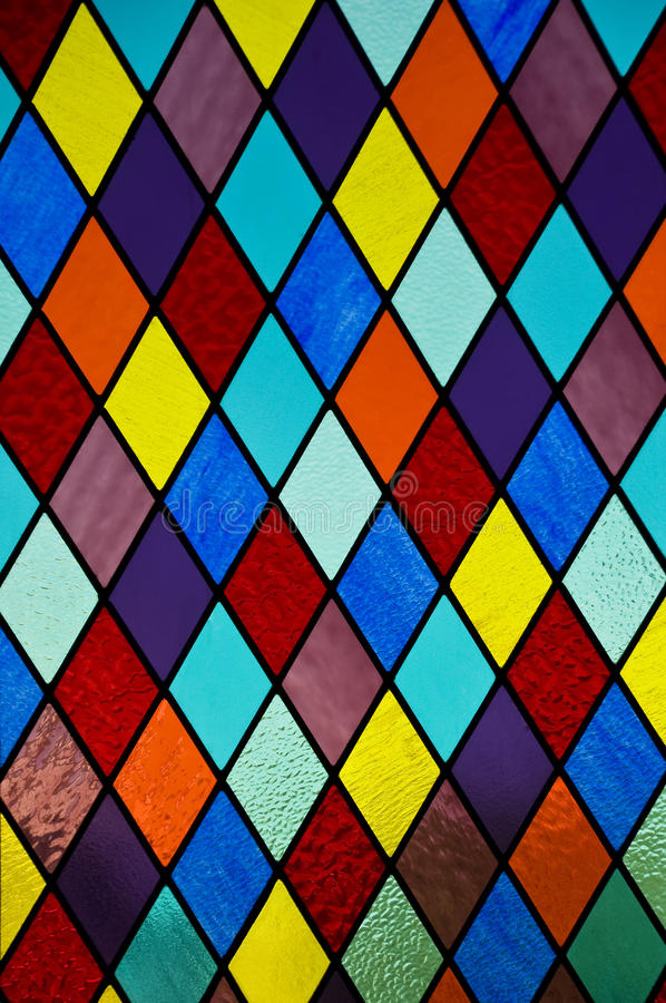 Stained glass with diamond pattern stock photos