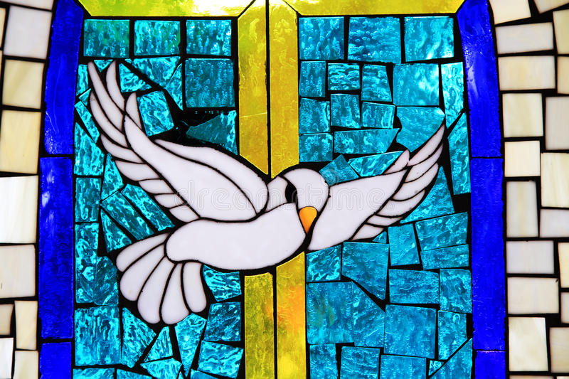 Stained Glass Dove of Peace. Photo of stained glass dove at Chimayo, New Mexico royalty free stock photos