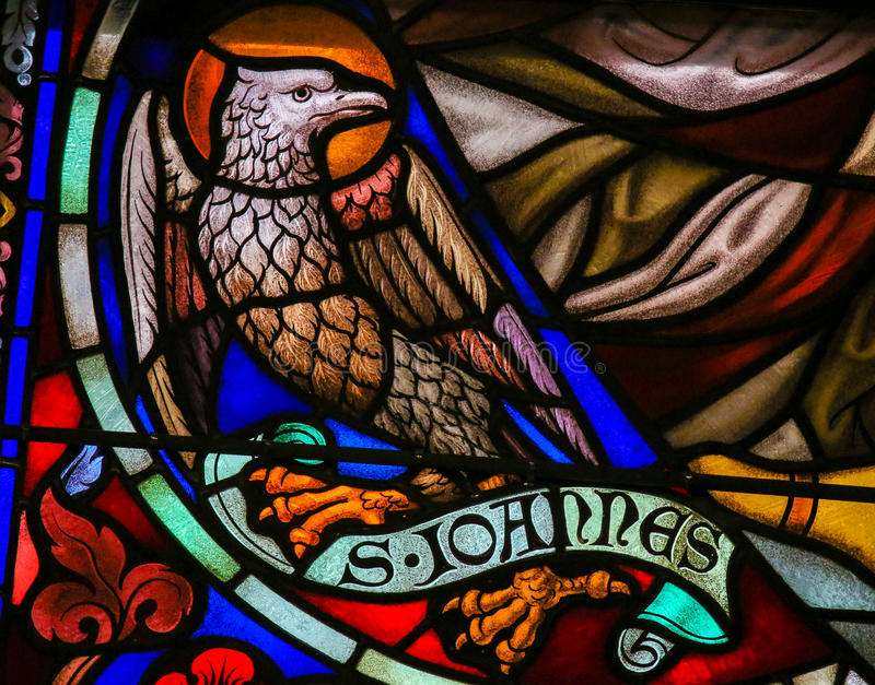 Stained Glass of the the Eagle - Saint John the Evangelist. Stained Glass window depicting the Eagle, symbol of Saint John the Evangelist, in the Cathedral of stock images