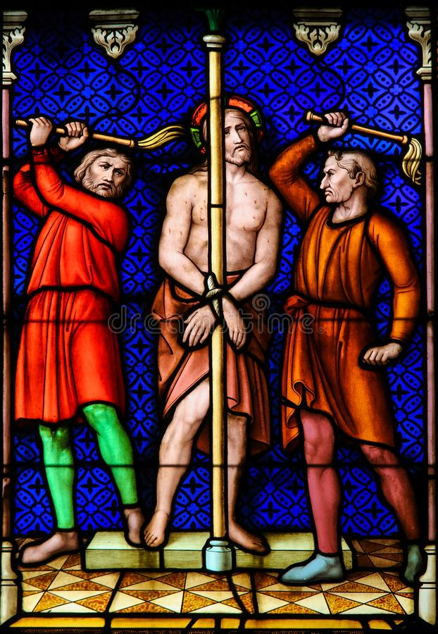 Stained Glass - Flagellation of Jesus Christ on Good Friday. Stained Glass in the Basilica of the Holy Blood in Bruges, Belgium, depicting the Flagellation of stock photography