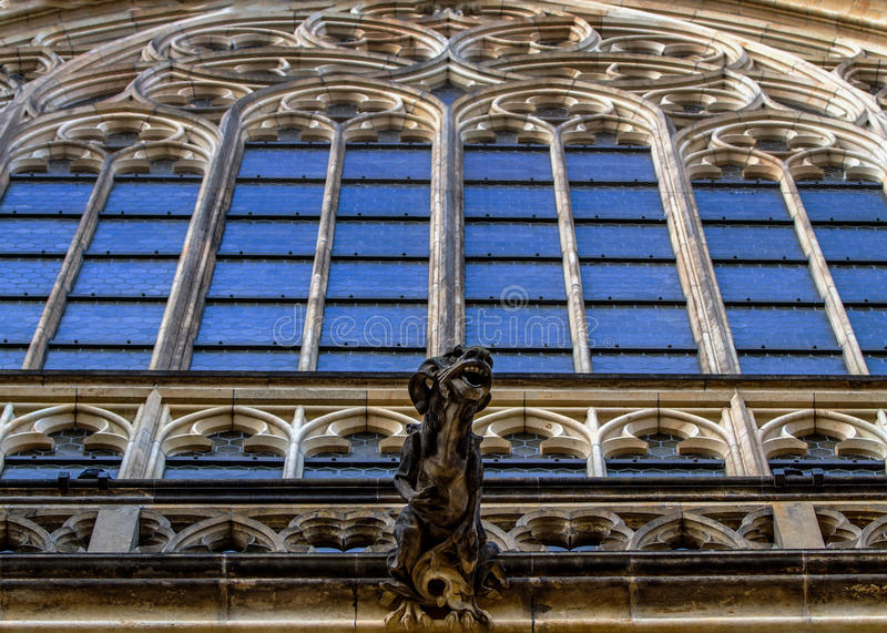 Stained glass and Gargoyle Statue on Saint Vitus Cathedral in Prague . Czech Republic. royalty free stock image