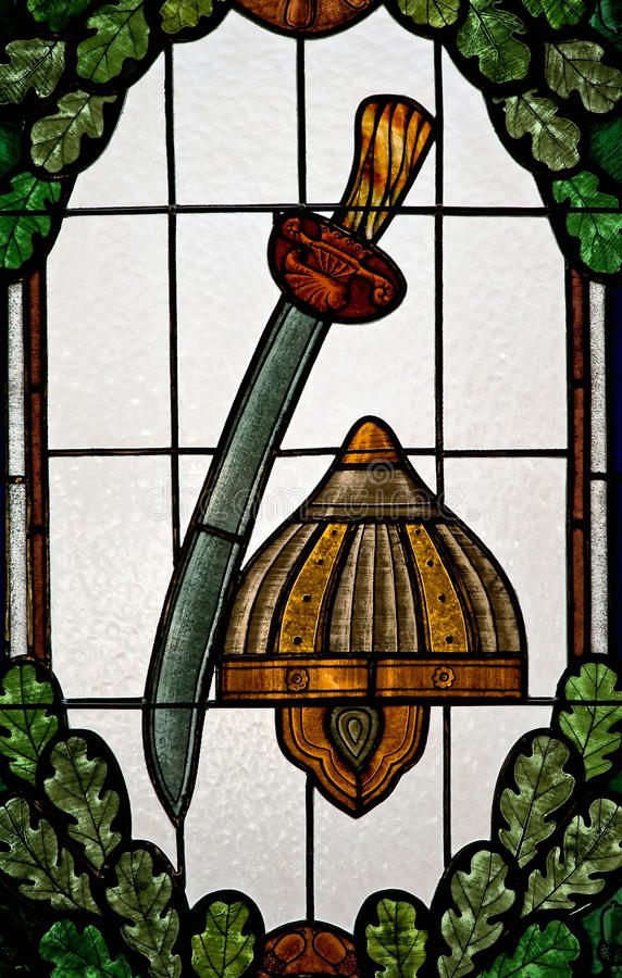 Stained glass. With helmet and sword stock image