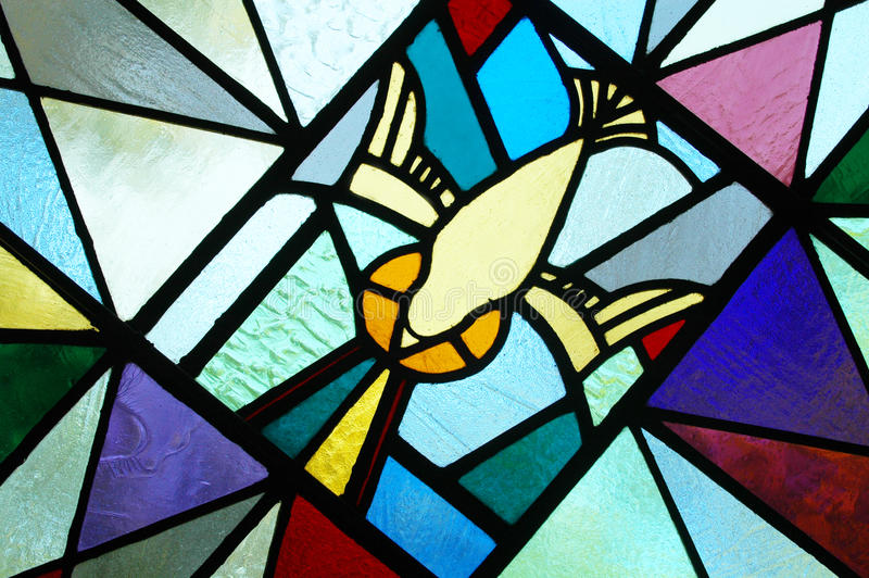 Stained Glass of the Holy Spirit. Modern stained glass of the Holy Spirit stock photography