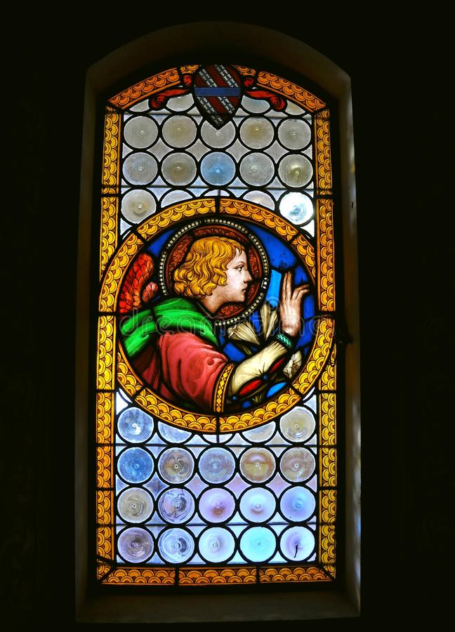 Stained glass in an Italian church. Stained glass on a church window in Fiesole, Italy. religious painting royalty free stock photo