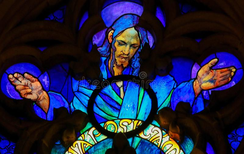 Stained Glass of Jesus Christ in Prague Cathedral. Stained Glass in St. Vitus Cathedral, Prague, designed by Alphonse Mucha, depicting Jesus Christ stock photo