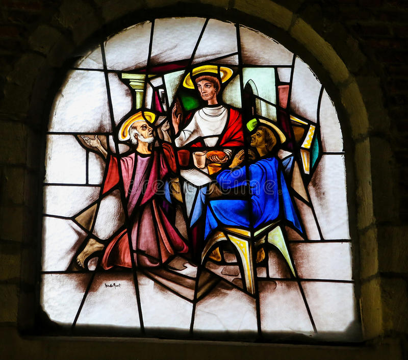 Stained Glass - Jesus and two disciples at Emmaus. Stained Glass window in the 15th Century Elzenveld Chapel in Antwerp, Belgium, depicting Jesus and two stock photos