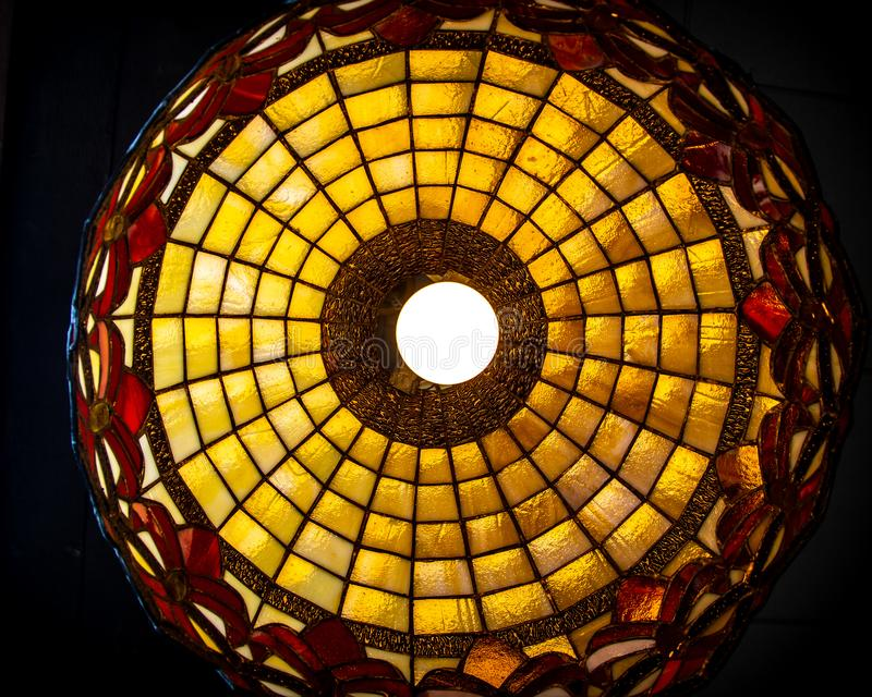Stained glass lamp looking up from below stock image