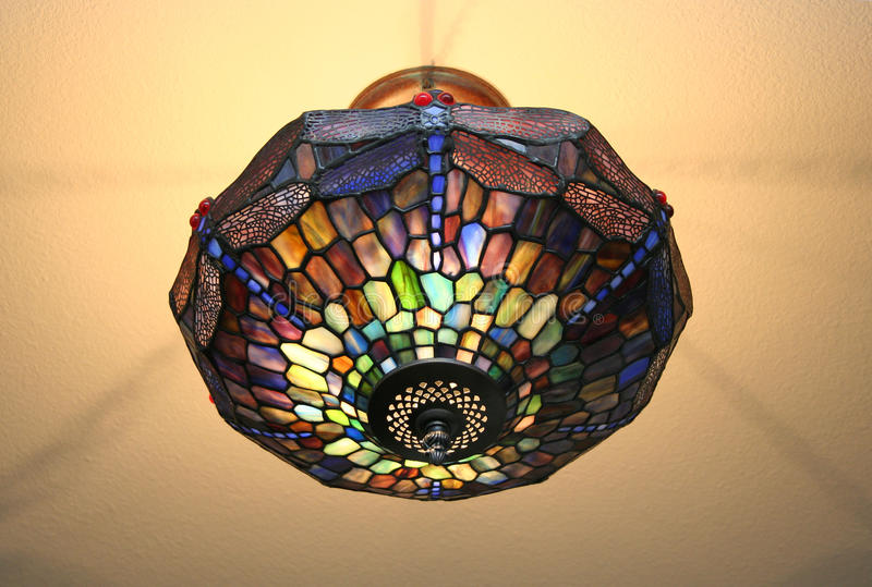 Stained Glass Light. A stained glass light fixture is very colorful stock photography