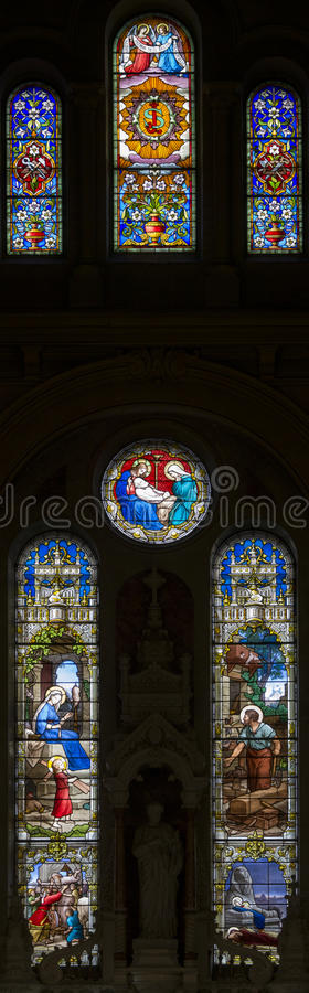Stained glass long church windows in different col royalty free stock photography