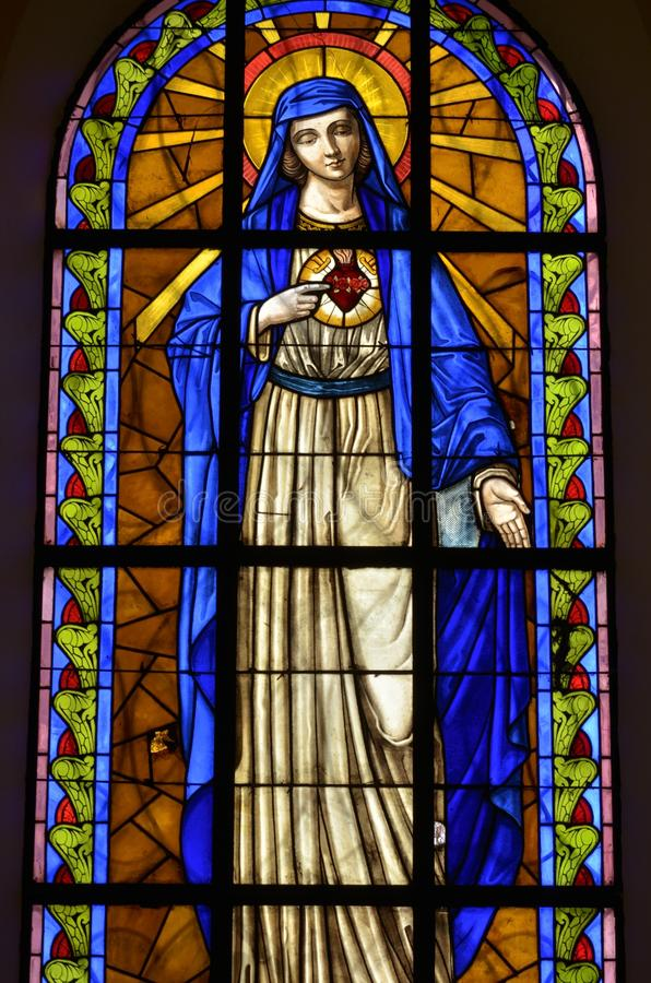 Stained glass mary. Mary is in stained glass window royalty free stock image