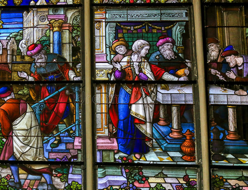 Stained Glass in Mechelen Cathedral. Stained Glass depicting the local legend of Jews stealing sacramental bread, in the Cathedral of Mechelen, Belgium. This royalty free stock photo