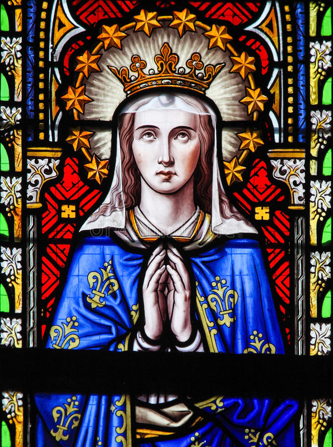 Stained Glass - Mother Mary. Stained Glass in the Church of Our Blessed Lady of the Sablon in Brussels, Belgium, depicting Mother Mary stock photo