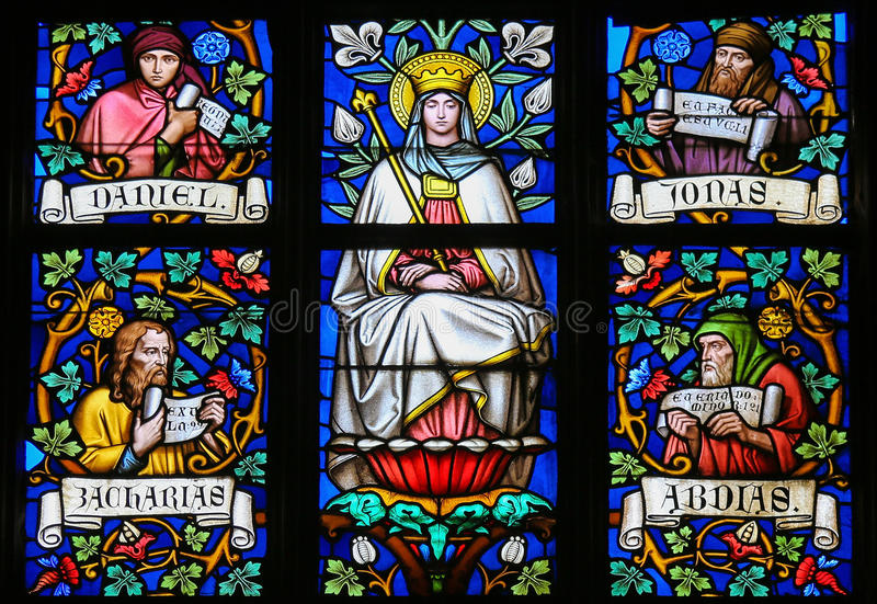 Stained Glass - Mother Mary and Prophets. Stained Glass window in St. Vitus Cathedral, Prague, depicting Mother Mary and the Prophets Daniel, Jonah, Zachary and stock photos