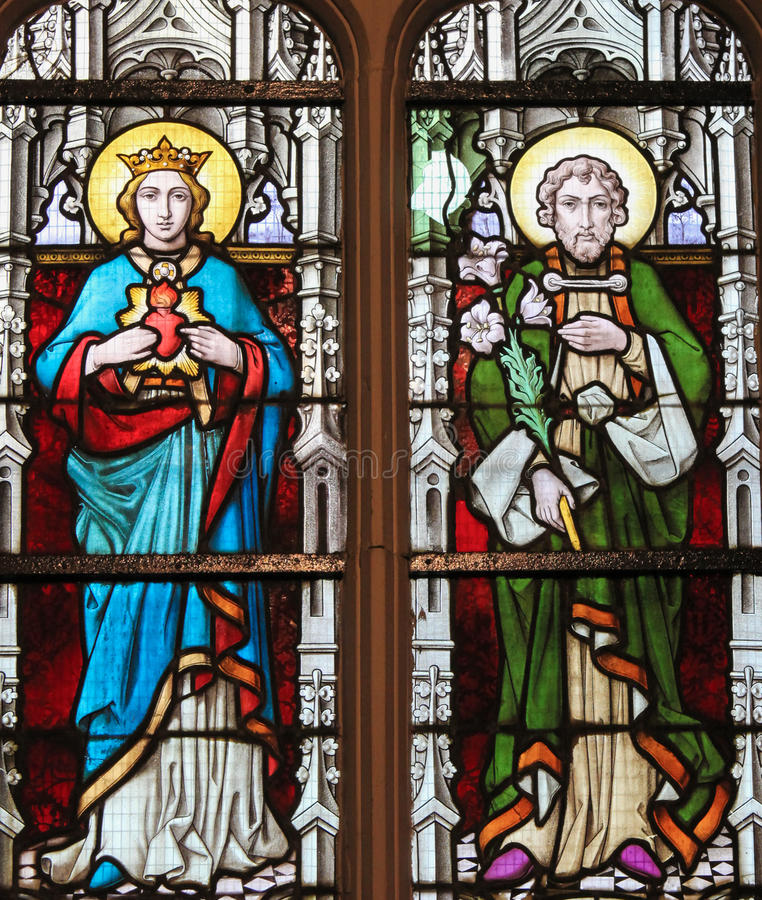 Stained Glass - Mother Mary and Saint Joseph. Stained glass window depicting Mother Mary and Saint Joseph, parents of Jesus Christ, in the Church of Stabroek royalty free stock photography