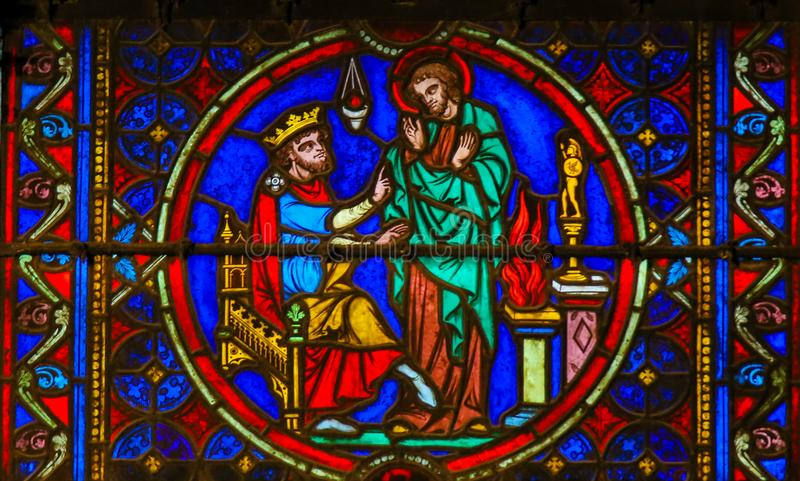 Stained Glass in Notre Dame, Paris depicting St Eustace and the Emperor Trajan royalty free stock photos
