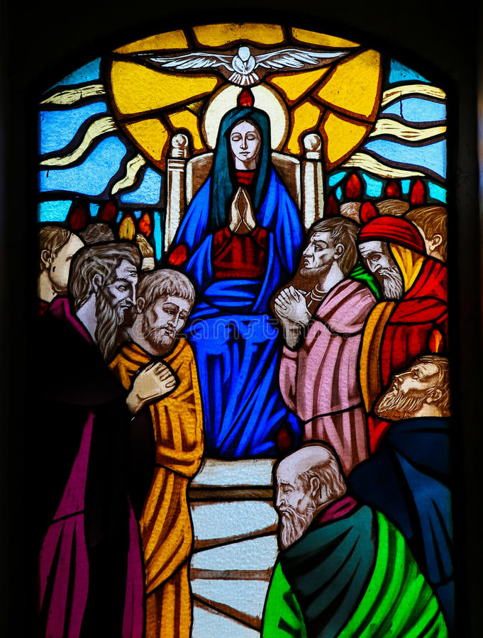 Stained Glass - Pentecost. Stained glass window depicting the Descent of the Holy Spirit at Pentecost, in the Church of Ostuni, Apulia, Italy stock image