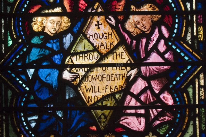 Stained Glass, psalm. Detail of stained glass window at chapel, Green-Wood Cemetery, Brooklyn. The chapel and cemetery date from 1838. Center panel reads Though royalty free stock photo