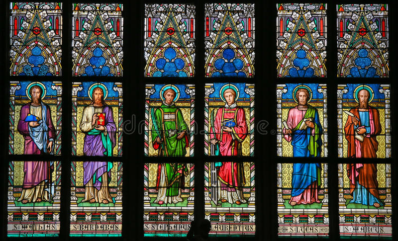 Stained Glass - Roman Catholic Saints. Stained Glass window in St. Vitus Cathedral, Prague, depicting various Roman Catholic Saints royalty free stock photography