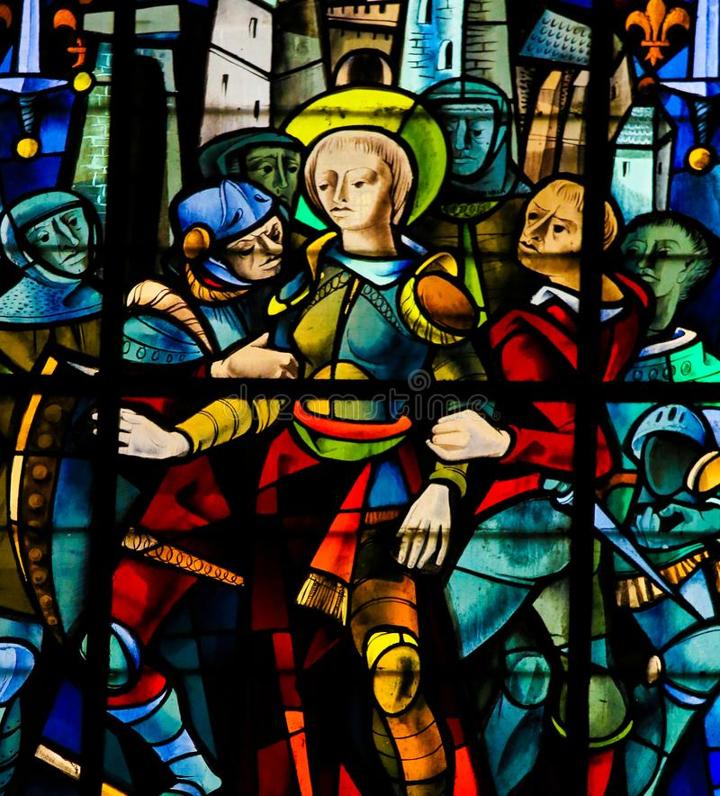 Stained Glass in Rouen Cathedral - Joan of Arc. Joan of Arc captured by the Burgundians at the Siege of Compiegne & x28;1430& x29; on a stained glass in the stock images