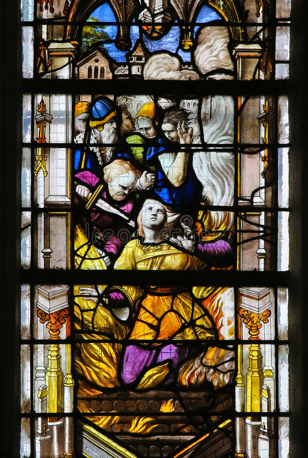 Stained Glass in Rouen Cathedral. Martyrdom of a Catholic Saint on a stained glass in the cathedral of Rouen, France stock photography