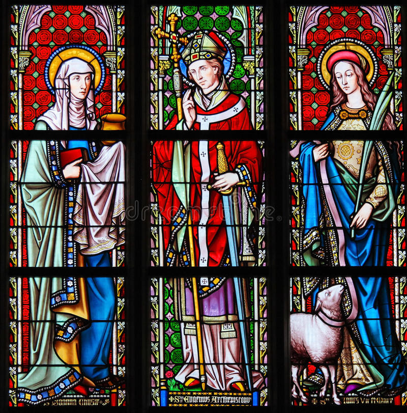 Stained Glass in Sablon Church - Saints Joanna, Eugene and Agnes stock photography
