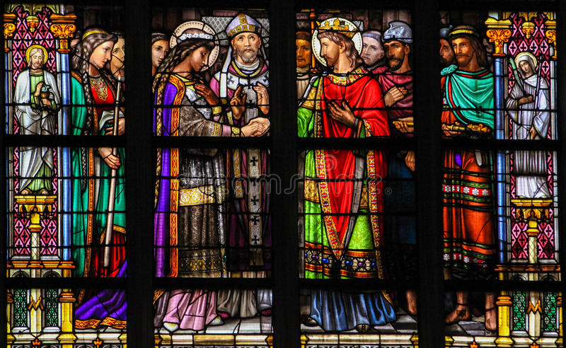 Stained Glass of the Sacrament of Marriage. Stained Glass Window depicting the Sacrament of Marriage or Holy Matrimony, with Pepin of Landen and Itesberga united royalty free stock photo