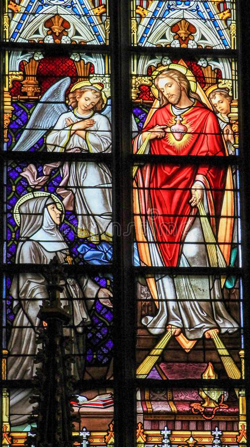 Stained Glass of Sacred Heart of Jesus in Den Bosch Cathedral stock photo