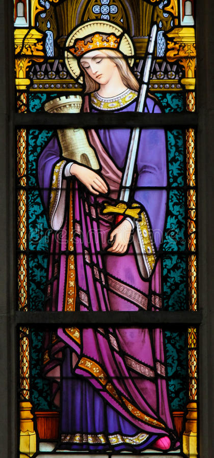 Stained Glass - Saint Barbara. Stained glass window depicting Saint Barbara, in the cathedral of Brussels stock photo