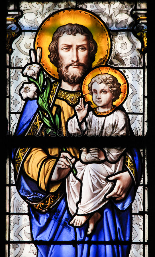 Stained Glass - Saint Joseph and Jesus as a Child. Stained Glass in Church of Saint-Germain-des-Pres in Paris, depicting Saint Joseph and Jesus as a Child royalty free stock photos