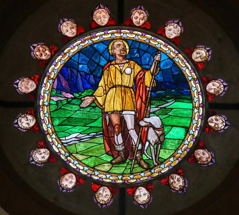 Stained Glass of Saint Roch in Bologna. Stained Glass in the Basilica of San Petronio, Bologna, Emilia Romagna, Italy, depicting Saint Roch or San Rocco, patron stock photos