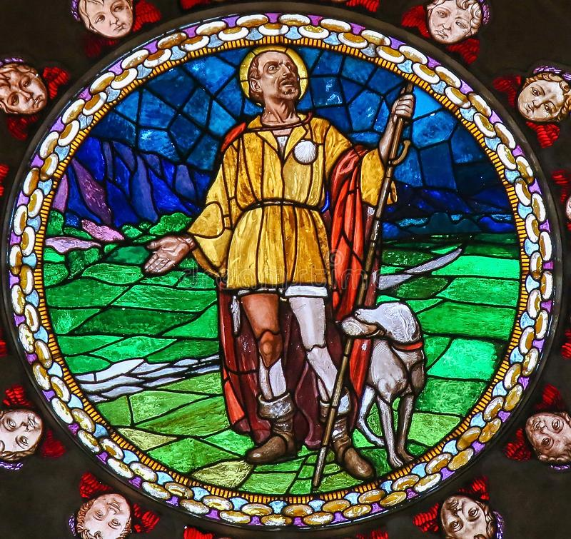 Stained Glass of Saint Roch in Bologna. Stained Glass in the Basilica of San Petronio, Bologna, Emilia Romagna, Italy, depicting Saint Roch or San Rocco, patron royalty free stock photos