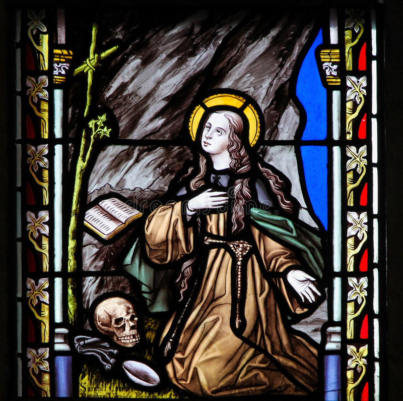 Stained Glass - Saint Rosalia. Stained Glass in the Church of Sablon in Brussels, depicting Saint Rosalia, also called La Santuzza or The Little Saint, the stock photos