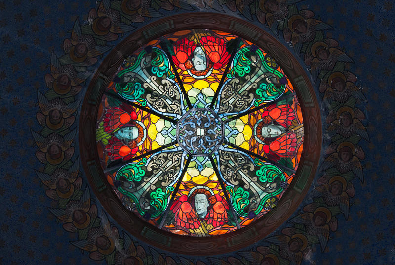 Stained glass skylight. Beautiful stained glass skylighting in a church stock images