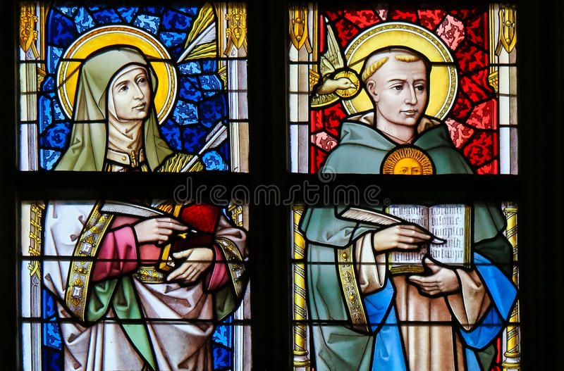 Stained Glass - Thomas Aquinas and Saint Teresa. Stained Glass in the Cathedral of Saint Bavo in Ghent, Belgium, depicting Saint Thomas Aquinas and Saint Teresa royalty free stock image