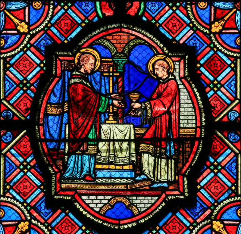 Stained Glass in Tours Cathedral - Eucharist. Stained glass window depicting Jesus and a Saint with the Eucharist in the Cathedral of Tours, France royalty free stock photos