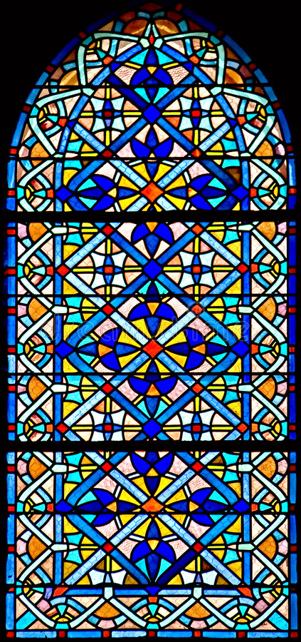 Stained-glass window 101. Stained-glass window in the old church stock photography