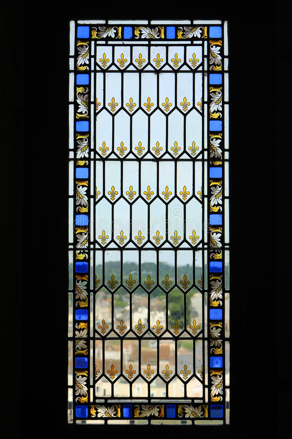 Stained glass window. Window in medieval castle in France, made of stained glass royalty free stock photography