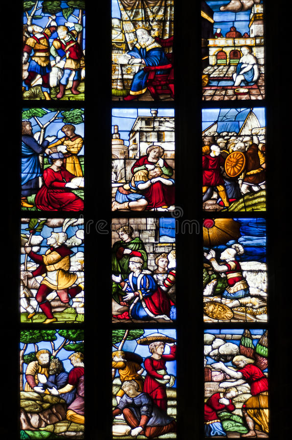 Stained glass window. Of the Milan Cathedral stock images