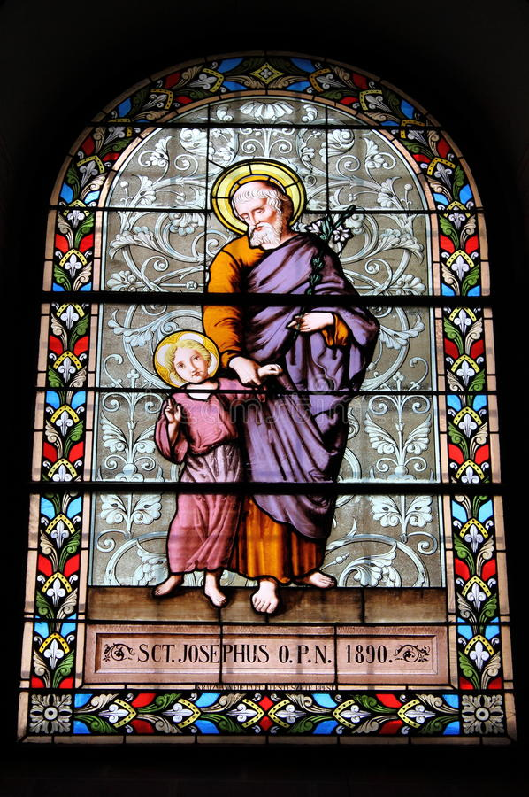 Stained glass window. With Saint Joseph and Jesus stock images