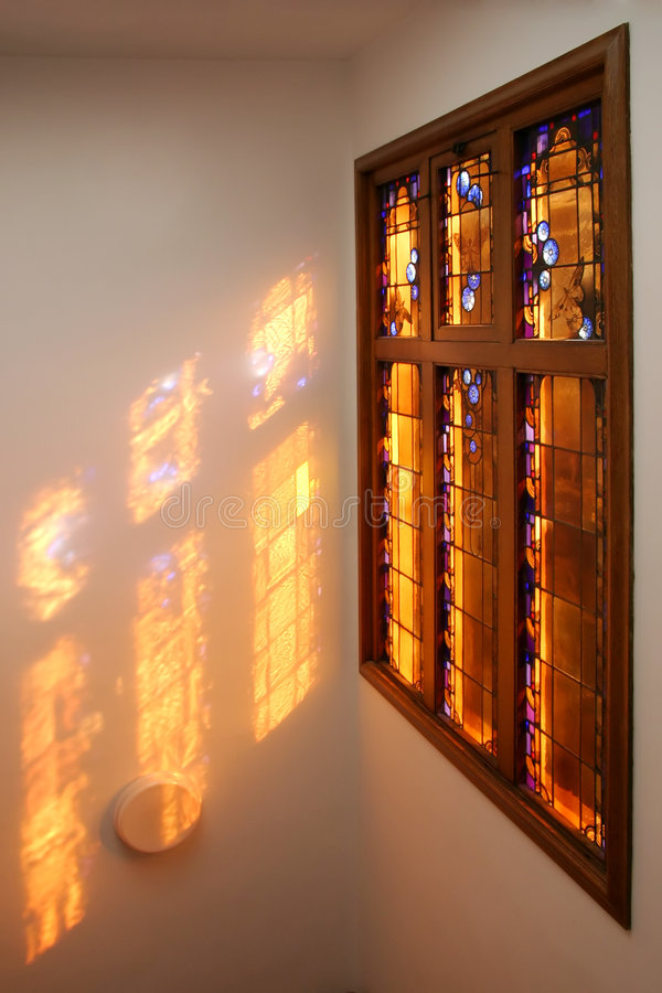 Stained glass window. With the sun coming through stock photography