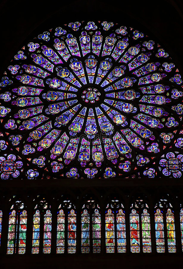 Stained glass window. North transcept rose stained glass window in Notre dame cathedral, Paris, France stock photography